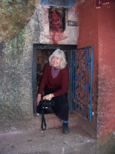 Award-winning poet, essayist and book artist, Marilyn Stablein, exiting a popular cave shrine in Kathmandu